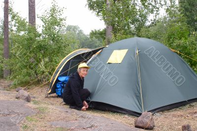Elderly woman in camping