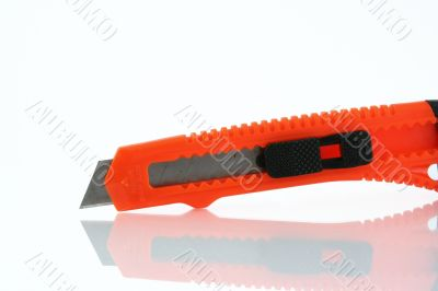 Orange razor knife reflection