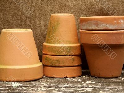 row of stacked terra cotta pots