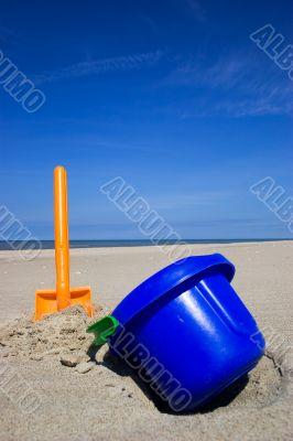 Beach spade and bucket