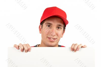 Curious teen behind white placard