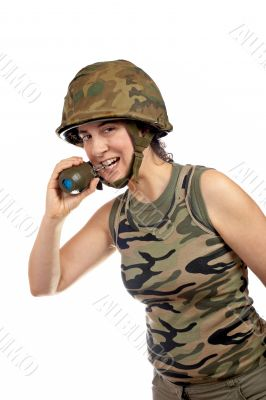 Soldier girl holding a hand grenade