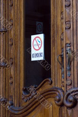 Opening door with no-smoking sign