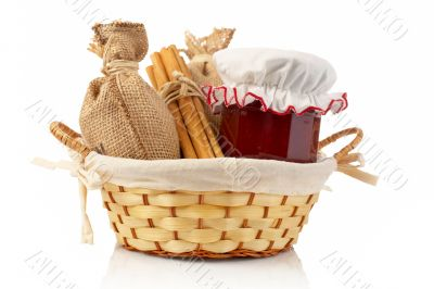 Jam jar, sticks of cinnamon and burlap