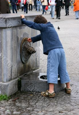 curious kid with fountain