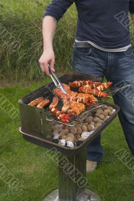 turning meat on barbecue