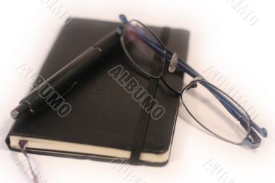 Pen, Diary and Glasses - shallow focus