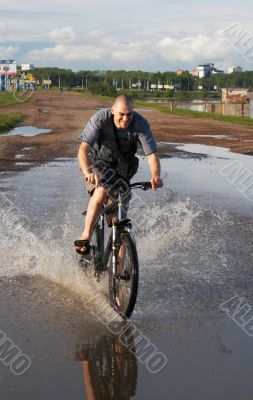 biker crossing the water