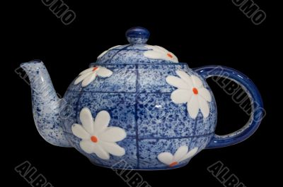 blue teapot over black background