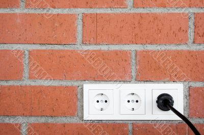 Brick Wall w/ Power Outlet