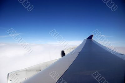 plane wing on a blue day