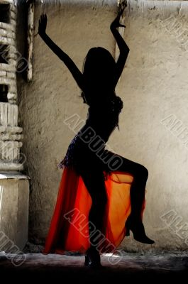 Woman dancing belly-dance in Oriental costume