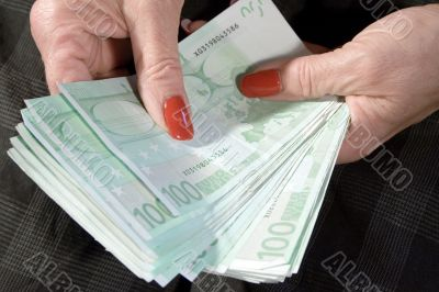 Businesswoman Counting Her Money