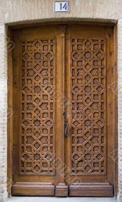 Medieval carved door with number