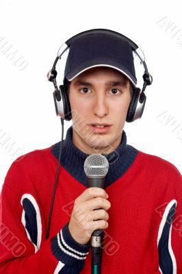 Disc jockey with headphones and microphone