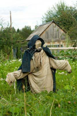 Garden scarecrow for scaring away of birds