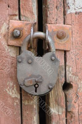 Wintage rusty metal gate padlock