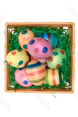 Colored Eggs in a Basket - Top View