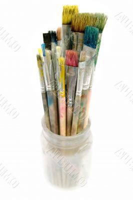 Used Paintbrushes in a Glass