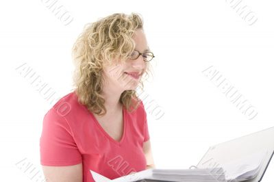 Attractive blonde with glasses checking a folder
