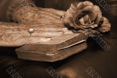 Senior hand on a bible