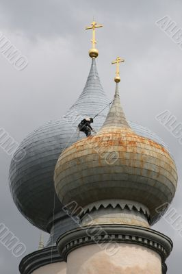 The spider-man on a dome of church