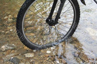 bike wheel in water