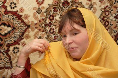 Woman in yellow wrap