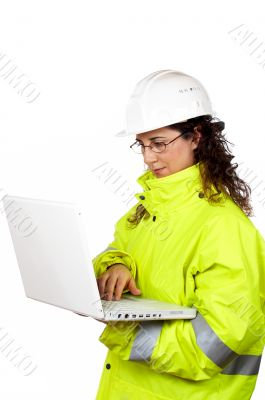 Female construction worker write in a laptop