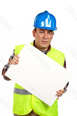Construction worker holding the blank poster