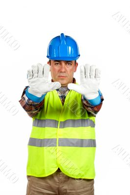 Construction worker with gloves, order to stop