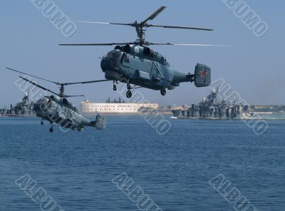 Helicopters on a background of an old sea fortress