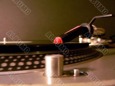 dj turntable needle on record