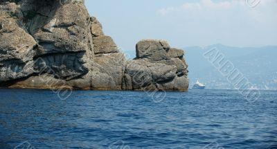 Yacht behind a rock