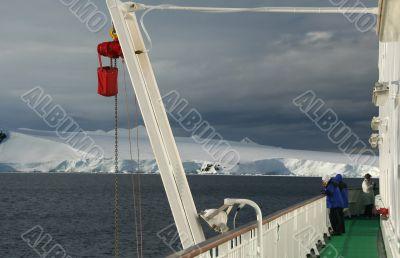 Cruise ship passenger photographing icebergs