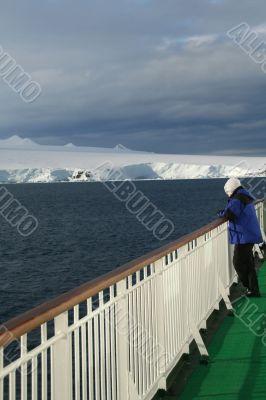 Cruise ship passenger viewing polar icebergs
