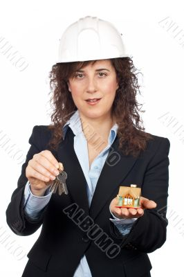 Female architect holding the keys and the house