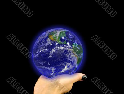 Glowing blue globe on hand