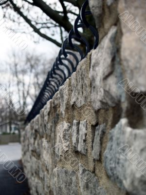 Stone Wall with Wrought Iron Caps