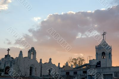 old church and antennas at sunset