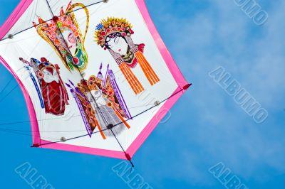 japanese style kite in flight in sunny day