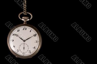 Old pocket watch on black