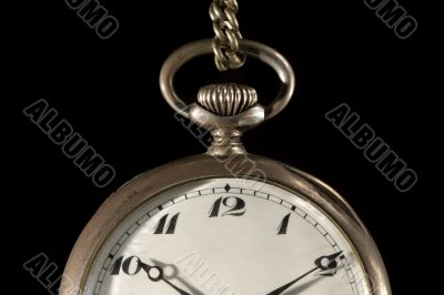 Old pocket watch on black detail