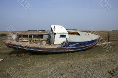 Small boat in the mud