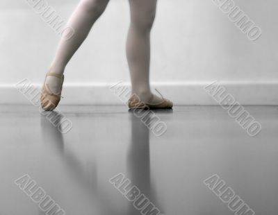 Dancer`s legs and ballet shoes