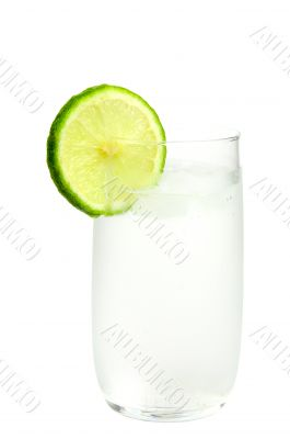 Glass of ice-cold water with slice of lime