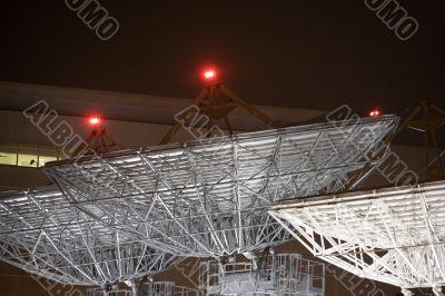 Satellite Communication Dishes at Night