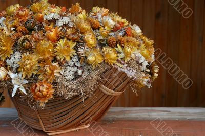 Bunch of dry flowers in basket