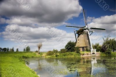 Dutch windmill with dramatic sky