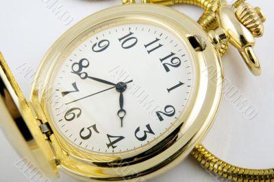 A close-up of a golden watch